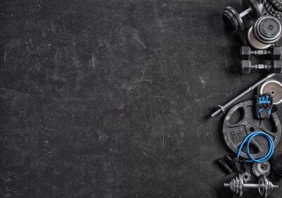Adesivo Attrezzature sportive su sfondo nero. Vista dall'alto. Motivazione