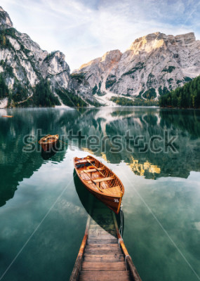 Adesivo Boats and slip construction in Braies lake with crystal water in background of Seekofel mountain in Dolomites in morning, Italy Pragser Wildsee