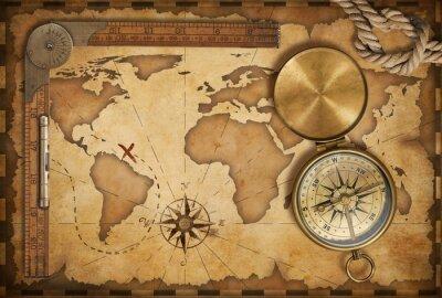 Adesivo di età compresa tra mappa del tesoro, righello, corda e vecchia bussola in ottone con coperchio