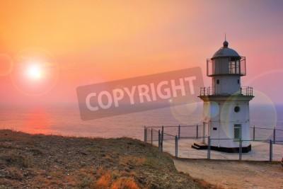 Adesivo Faro sulla costa all'alba