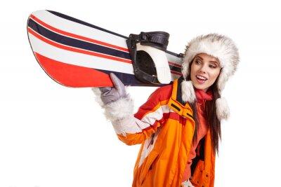 Adesivo Giovane donna in piedi con lo snowboard isolato su bianco
