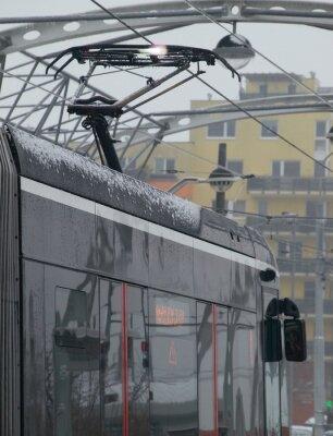 Adesivo Gli scarichi del tram sul carrello con ghiaccio
