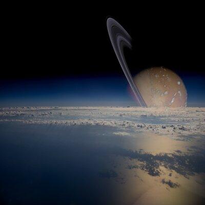 Adesivo Guarda da un satellite in orbita attorno a un pianeta con gli anelli.