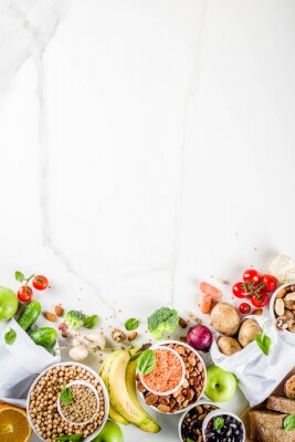 Adesivo Healthy food. Selection of good carbohydrate sources, high fiber rich food. Low glycemic index diet. Fresh vegetables, fruits, cereals, legumes, nuts, greens.  copy space
