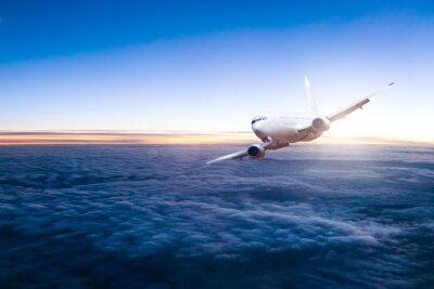 Adesivo jet commerciale aeroplano volare sopra le nuvole