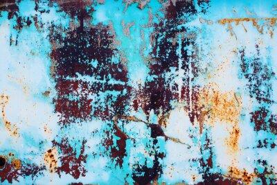Adesivo metallo arrugginito con vernice blu incrinato. sfondo colorato di superficie di ferro arrugginito con un brillante vernice blu peeling e la consistenza di cracking