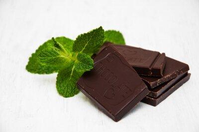 Adesivo Parti del cioccolato con una foglia di menta