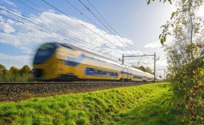 Adesivo Passenger train moving at high speed in sunlight