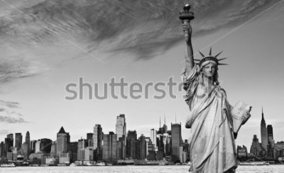 Adesivo photo statue of liberty new york city black and white hi contrast. nyc new york city skyline over Manhattan cityscape midtown. statue of liberty over hudson river in new york city.