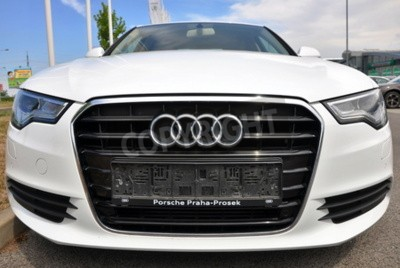 Adesivo PRAGUE, THE CZECH REPUBLIC, 02.08.2015 - Brand new white Audi A6 parks in front of Car Store Audi