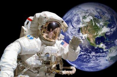 Adesivo Primo piano di un astronauta nello spazio, la terra in background - elementi di questa immagine sono fornite dalla NASA