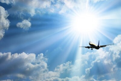 Adesivo Silhouette of airplane with a beautiful sky