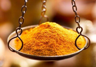 Adesivo spezie in polvere di curry in ciotola pesi