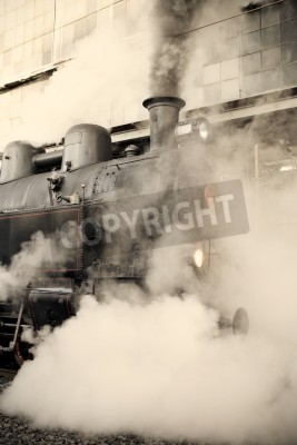 Adesivo Steam locomotive at the railway station wrapped up in cloud - vintage retro tinting