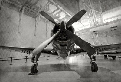 Adesivo Vecchio aereo in un hangar