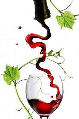Adesivo Versare il vino rosso in vetro con asta isolato su bianco