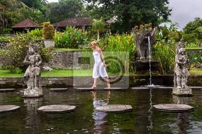Adesivo Young women near Water Palace Tirthagangga. Bali Indonesia