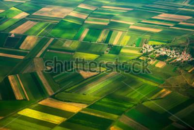 Carta da parati aerial photo from a plane, top view, field roads and city