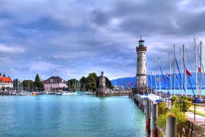 Carta da parati Affacciato sul porto sull'isola di Lindau, sul Lago di Costanza, nella Germania meridionale con il suo storico faro.