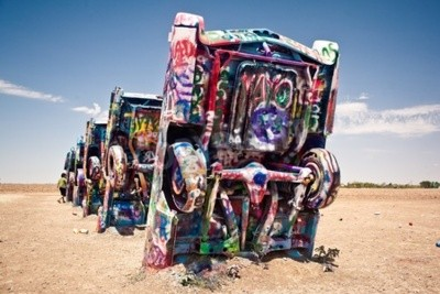 Carta da parati AMARILLO, TEXAS - JULY 10: Famous art installation of the old Cadillac cars on July 10, 2011 at Cadillac Ranch near Amarillo, Texas. It was created in 1974 by Chip Lord, Hudson Marquez and Doug Michel