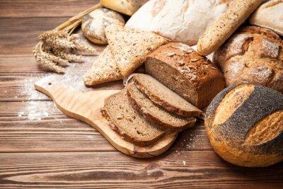 Carta da parati Assortimento del pane sulla superficie di legno
