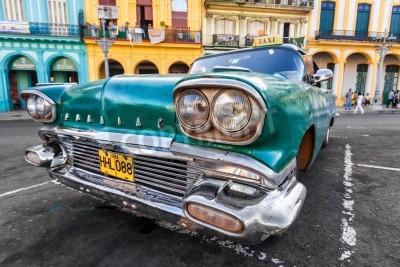 Carta da parati Auto d'epoca in un quartiere colorato a L'Avana