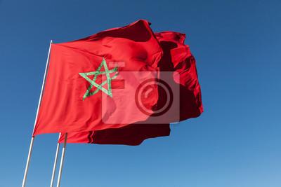 Carta da parati Bandiere nazionali del Marocco sopra il cielo blu chiaro