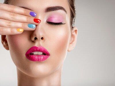 Carta da parati Beautiful fashion woman with a colored nails. Attractive white girl with multicolor manicure.