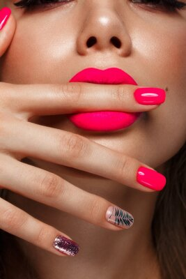 Carta da parati Beautiful young woman with bright makeup and neon pink nails. Beauty face. Photo taken in the studio