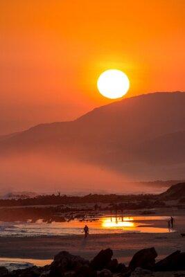 Carta da parati Bello tramonto con grande sole tondo