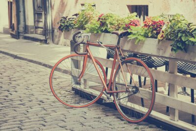 Carta da parati Bicicletta su Old Street. Vintage stilizzata.