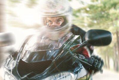 Carta da parati Biker sulla strada di guida veloce