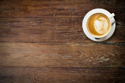 Carta da parati caffè latte su legno con lo spazio.
