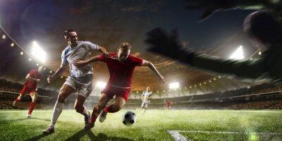 Carta da parati Calciatori in azione sul tramonto sfondo dello stadio panorama