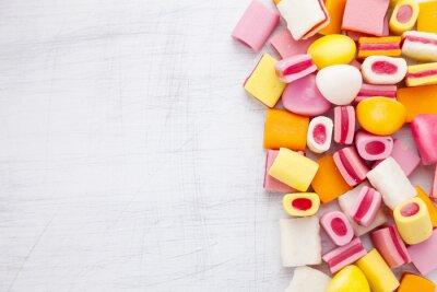 Carta da parati caramella dolce Delicious con lo spazio della copia