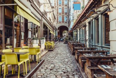 Carta da parati Cozy street near Boulevard San-German with tables of cafe and pub  in Paris, France. Architecture and landmarks of Paris. Postcard of Paris