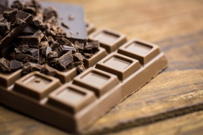 Carta da parati Dark and milk chocolate on a wooden table