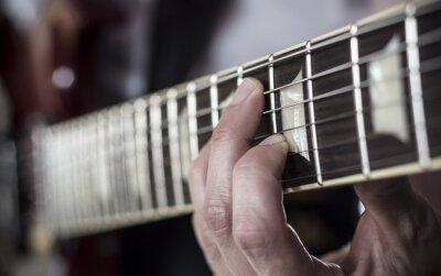 Carta da parati Dedos sobre diapasón de guitarra