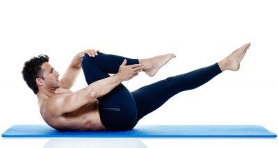 Carta da parati esercizi di fitness uomo di pilates isolato
