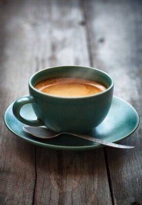Carta da parati Espresso caffè in una tazza verde, messa a fuoco selettiva