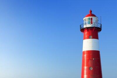 Carta da parati Faro rosso e bianco e un cielo blu chiaro