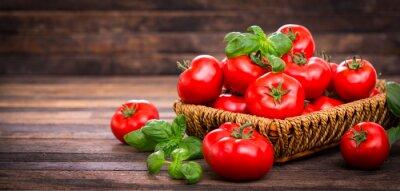 Carta da parati Fresh ripe tomatoes and basil in the basket