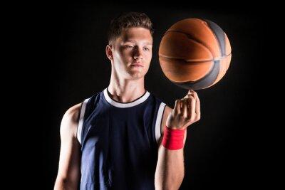 Carta da parati Giocatore di basket filatura palla sul dito