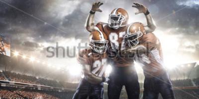 Carta da parati Giocatori di football americano nell'azione sulla vista di panorama dello stadio