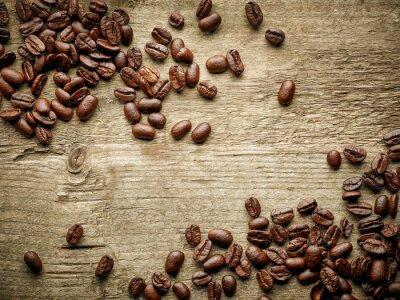Carta da parati I chicchi di caffè sul tavolo in legno