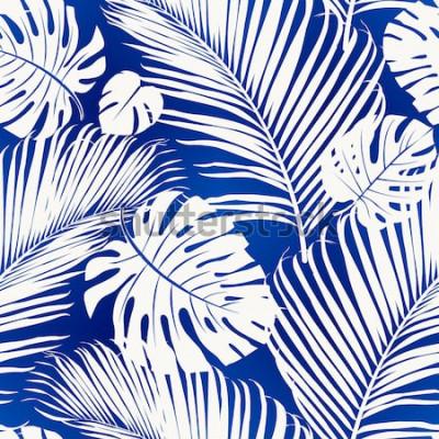 Carta da parati Il modello senza cuciture di ripetizione con le siluette bianche della palma lascia su fondo blu.