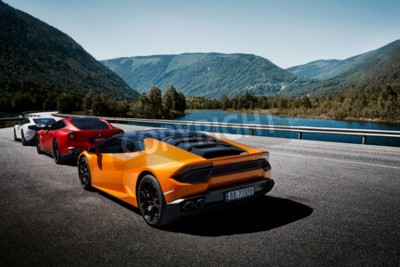 Carta da parati Miland, Norway. 04.06.2016: Yellow Lamborghini Huracan, Red Ferrari f12m and white Mclaren 650s