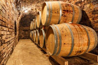 Carta da parati Oak barrels in a underground wine cellar