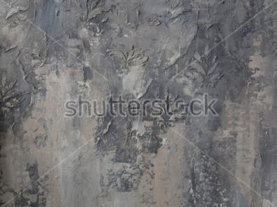 Carta da parati ornamento su un muro di cemento grigio