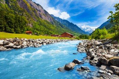 Carta da parati Paesaggio svizzero con flusso del fiume e le case